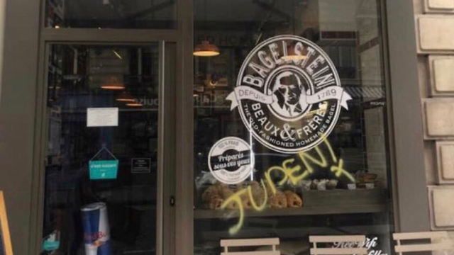 The German word for 'Jew' is painted on a bagel shop in Paris