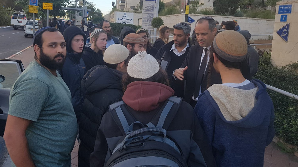 Keidar surrounded by Hilltop Youth outside the courtroom