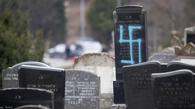 A swastika daubed on a grave in a descrated Jewish cemetery in France (Photo: AP)