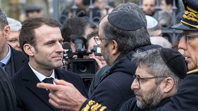 Emanuel Macron talks to members of the French Jewish community at a vandalized Jewish cemetery in Alsace (Photo: AP) (Photo: AP)