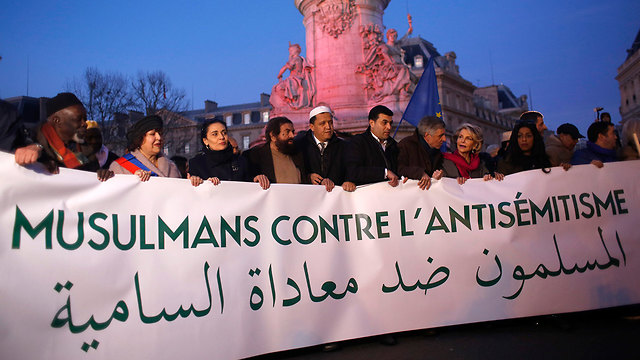 French Muslims attend the protest against anti-Semitism in Paris (Photo: AP)