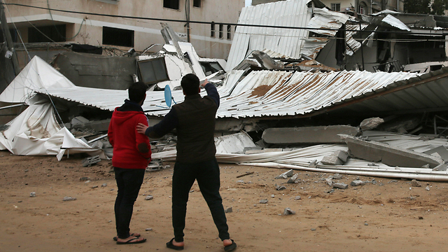 Palestinians inspect the damage from an IAF airstrike in Gaza (Photo: AP)