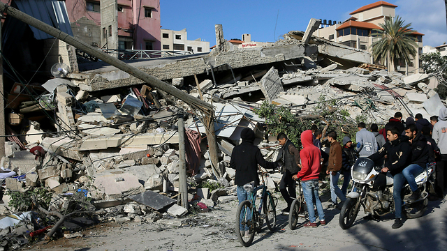 Gazans inspect a demolished building after IAF strikes overnight (Photo: AP) (Photo: AP)