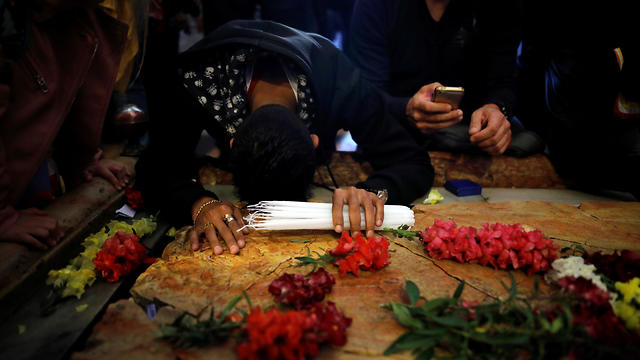 A worshipper prays in the Church of the Holy Sepulchre on Good Friday (Photo: Reuters)