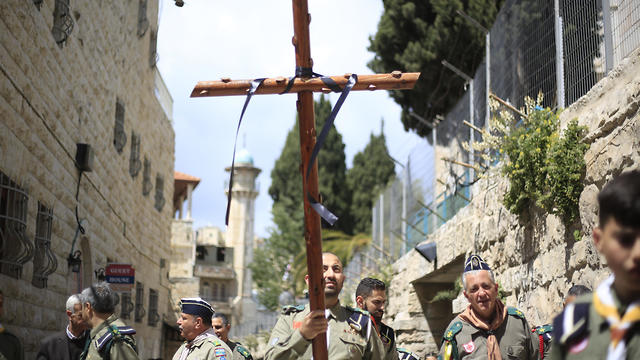 Christians from the boys scouts movement walk along the Via Dolorosa on Good Friday  (Photo: AP)