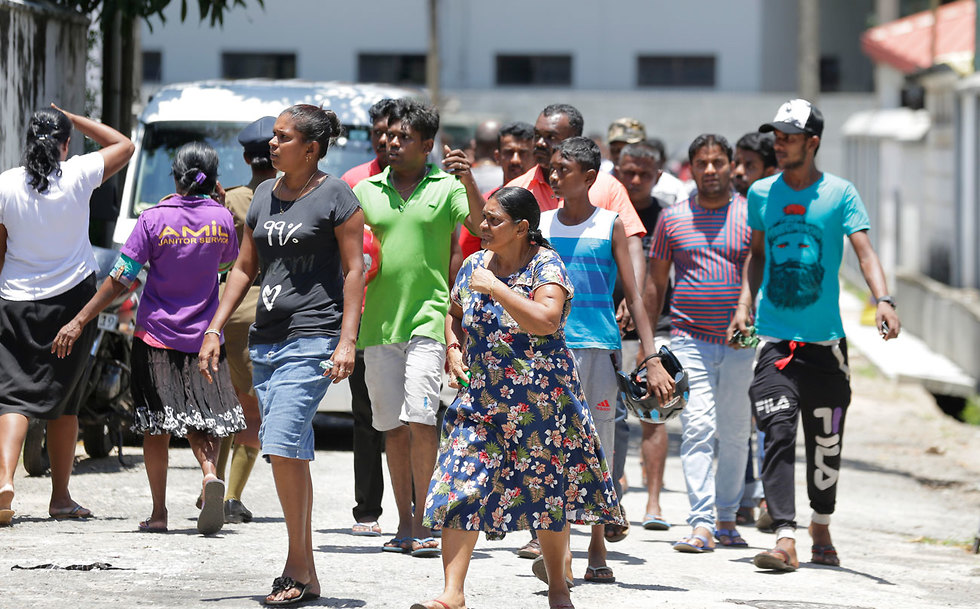 Families of victims of the Sri Lanka bombings gather at a hospital in Colombo (Photo: AP)