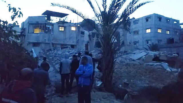 Palestinians inspect damage caused by IDF strikes in Gaza (Photo: IDF Spokesperson's Unit)