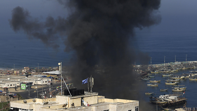 Smoke rises over a Gaza marine facility following IDF strikes (Photo: AFP)