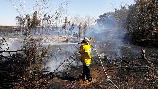 Firefighters put out a blaze in Kibbutz Nahal Oz in southern Israel  (Photo: AFP)