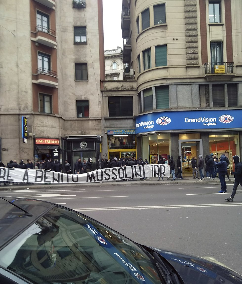 """Banner saying """"honor to Benito Mussolini"""" carried by the Lazio soccer team fans in Milan in April   (Photo: AP)"""