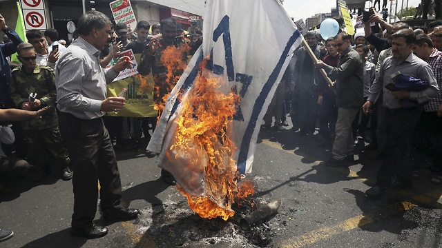 Iranian protesters burn Israeli flags during Al-Quds Day (Photo: AP)
