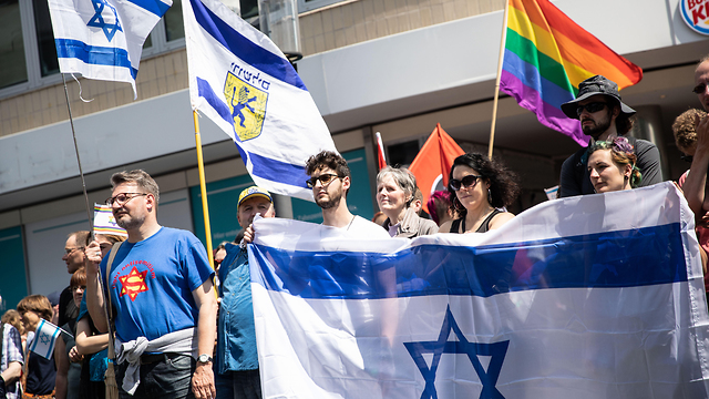 Supporters of Israel wave Israeli flags at a demonstration in Berlin on June 1, 2019 (Photo: Getty Images)