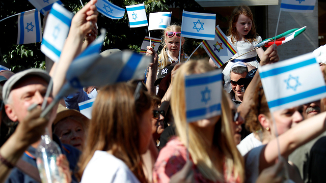 Supporters of Israel wave Israeli flags at a demonstration in Berlin on June 1, 2019 (Photo: Reuters)