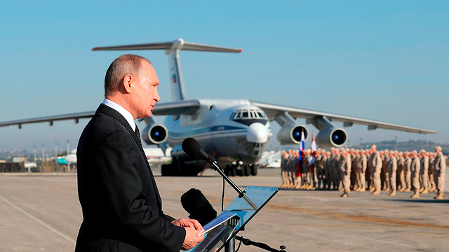 Vladimir Putin addressing Russian troops in Latakia, Syria earlier this year (Photo: AP)