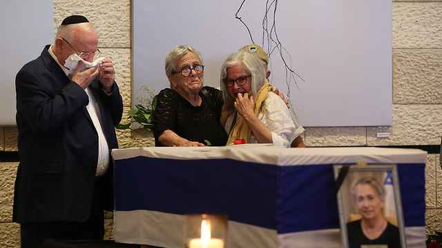 President Reuven Rivlin mourns his wife as her coffin lies in state in Jerusalem Theater (Photo: Amit Shabi)