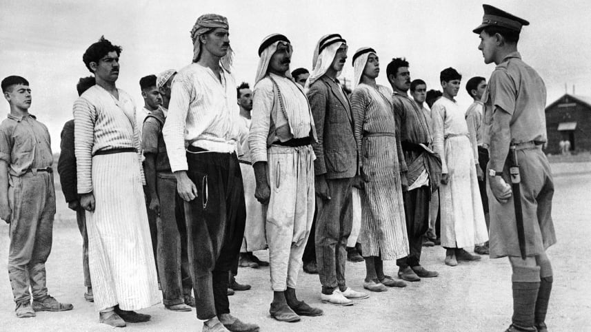 Arab new recruits line up for a British army drill in Mandatory Palestine, December 28, 1940 (Photo: AP)