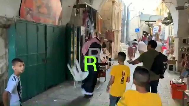 Chairs are thrown at Mohammed Saud in the Old City of Jerusalem