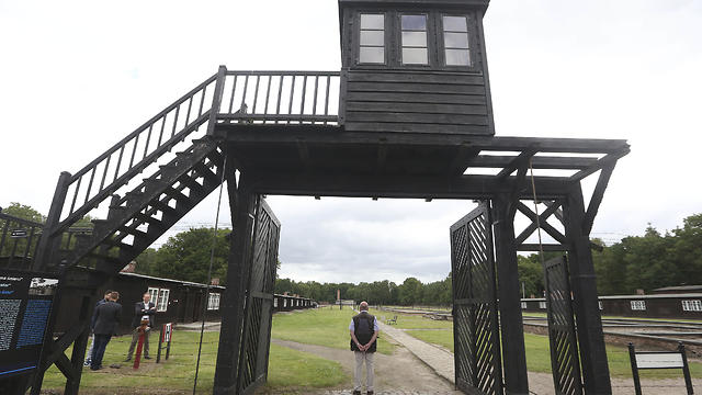 In this July 18, 2017 file photo the wooden main gate leading into the former Nazi German Stutthof concentration camp photographed in Sztutowo, Poland