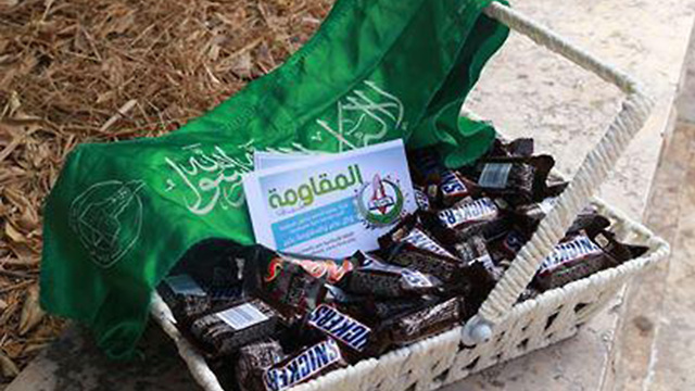 Palestinians hand out candies in celebration of the killing
