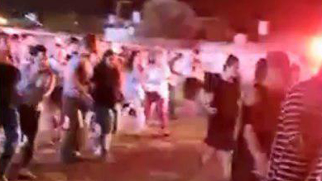 Sderot residents running for cover as Gaza terrorists fire rockets during a music festival in the city