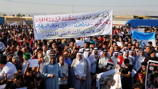 Militias protest against the order to leave their checkpoints in Mosul, July 2019 (Photo: Reuters)