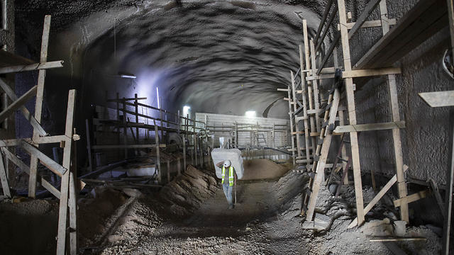 A worker walks at the construction site of a massive underground cemetery in Jerusalem, August 18, 2019    (Photo: AP)