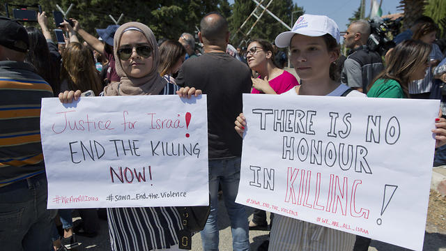 Palestinian women hold placards at a protest in Ramallah demanding an investigation into the death of Israa Ghrayeb, September 2, 2019