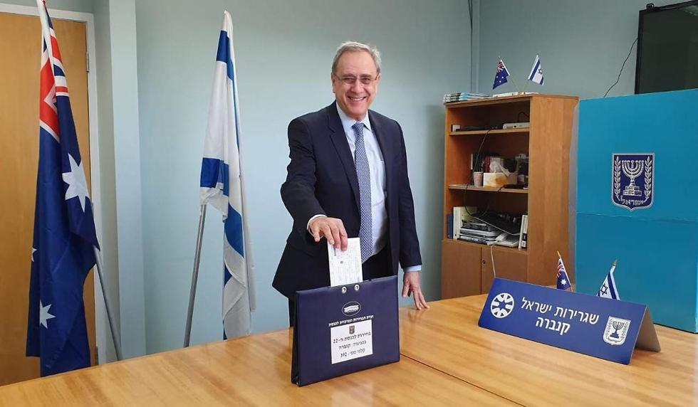 Israel's Ambassador to Australia Mark Sofer casts his vote in Canberra ahead of Tuesday's elections