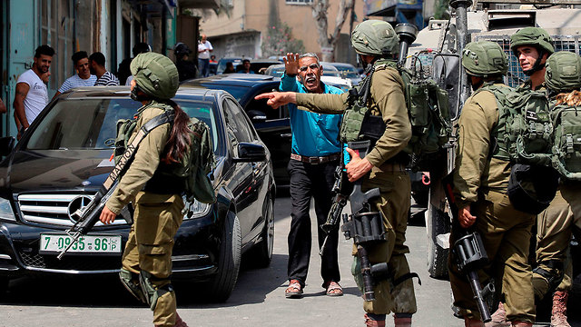 IDF troops near Azzun in the West Bank following the attack (Photo: AFP)