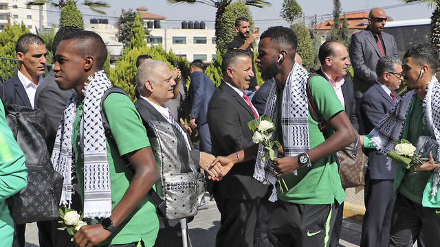 Members of the Palestine Football Federation welcome Saudi Arabia's national football team in Ramallah, Oct. 13, 2019