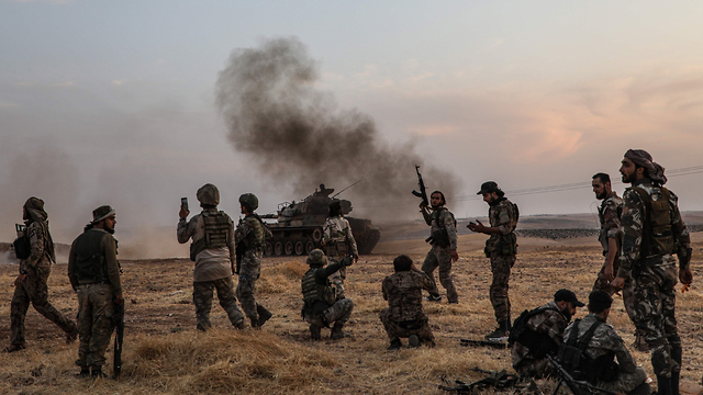 Turkish forces and their Syrian rebel allies advance on a Kurish city in nothern Syria (Photo: AFP)