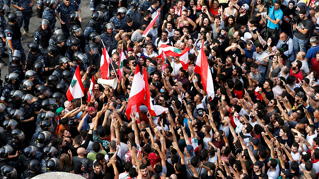 Lebanese protesters clashing with police in Beirut  (Photos: Reuters)