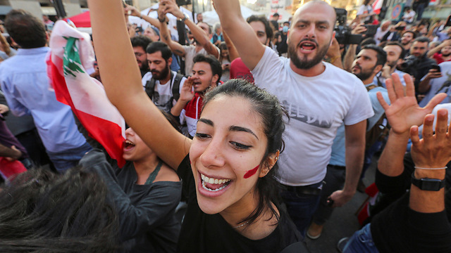 Lebanese protesters celebrate in Beirut at news of PM Saad Hariri's resignation (Photo: Reuters)