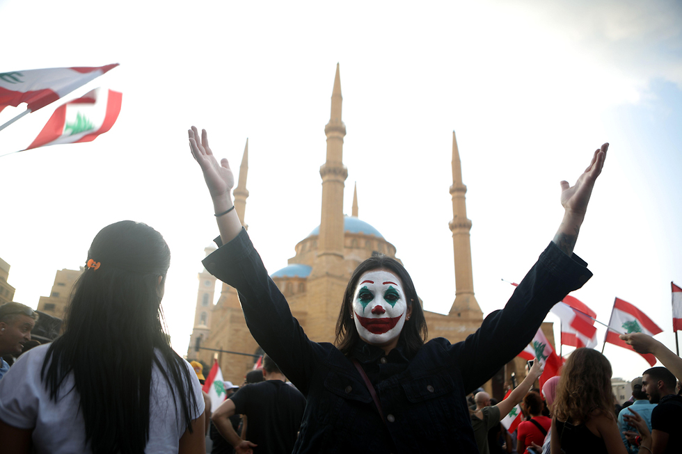 A protester in Beirut dressed as Joker  (Photo: AFP)