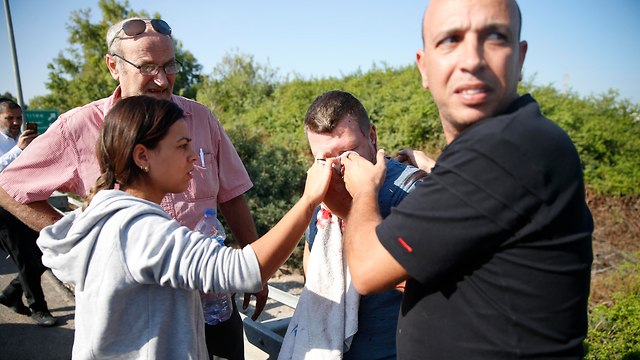 A man is treated for shrapnel wounds after the rocket strike on Gan Yavne  (Photo: AP)