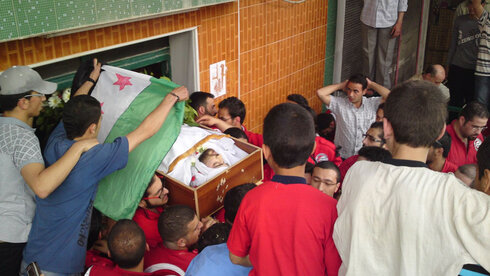 The funeral of an opposition leader in Douma, Syria in 2012