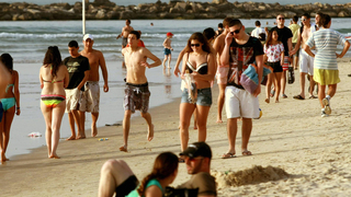 Israelis soaking up the sun on Tel Aviv beach