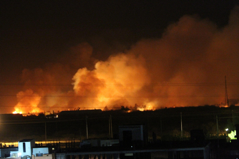 The Yarmouk munitions factory in flames after an attack attributed to Israel