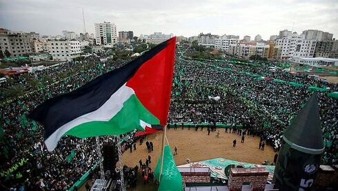 Hamas supporters in Gaza celebrate the group's 25th anniversary
