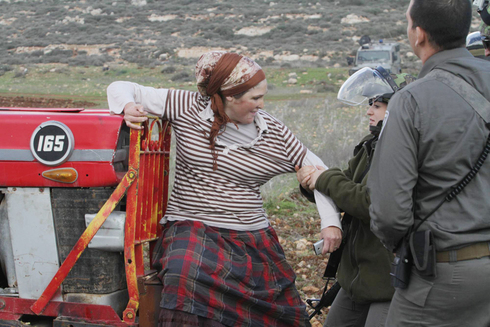 Israeli troops clash with settlers near the illegal West Bank outpost of Esh Kodesh