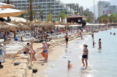 Tourists on the beach in the southern resort town of Eilat