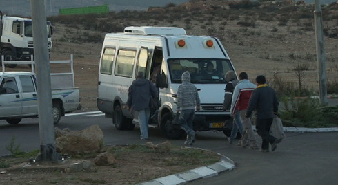 Palestinian workers return to the West Bank from working in Israel