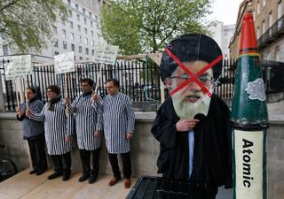Iranian opposition activists demonstrate in London against the regime in Tehran