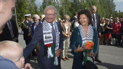 Sweden's king, Carl XVI Gustaf, donning a keffiyeh with the colors of the Palestinian flag