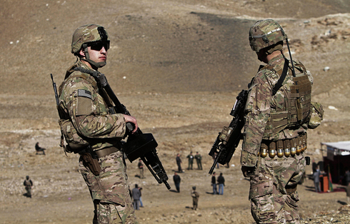 U.S. soldiers observe as Taliban's opium fields are destroyed