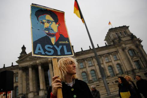 A protest in front of the Bundestag in Germany, calling for the government to provide Edward Snowden with asylum