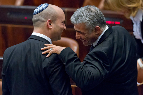 Yamina leader Naftali Bennet and Yesh Atid leader Yair Lapid in the Knesset in 2014