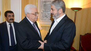 Fatah chief and Palestinian president Mahmoud Abbas and Hamas political leader Khaled Mashal during peace talks between the two rival groups in Qatar in 2014