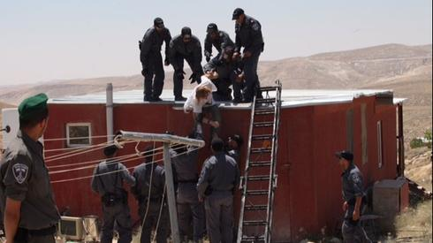 Security forces remove settlers from illegal West Bank outpost