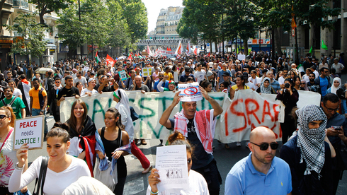 Pro-Palestinian protesters marching Paris during the latest round of fighting between Israel and Gaza's terrorist factions
